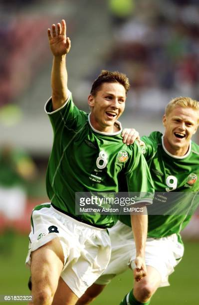 Matt Holland of Ireland celebrates after scoring the equalising goal with Damien Duff against Cameroon