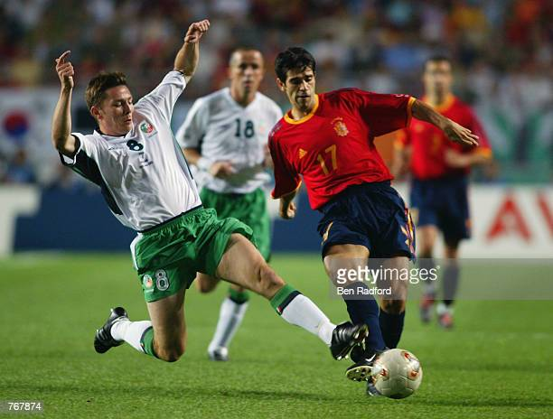 Matt Holland of the Republic of Ireland tackles Juan Carlos Valeron of Spain during the FIFA World Cup Finals 2002 Second Round match played at the...