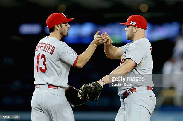 Matt Holliday and Matt Carpenter of the St Louis Cardinals celebrate thei 109 win over the Los Angeles Dodgers in Game One of the National League...