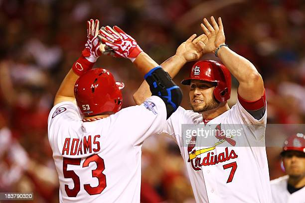 Matt Holliday congratulates Matt Adams of the St Louis Cardinals on his tworun home run in the eighth inning against the Pittsburgh Pirates during...