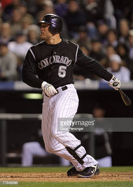Matt Holliday of the Colorado Rockies hits a single in the bottom of the first inning against the Arizona Diamondbacks during Game Four of the...