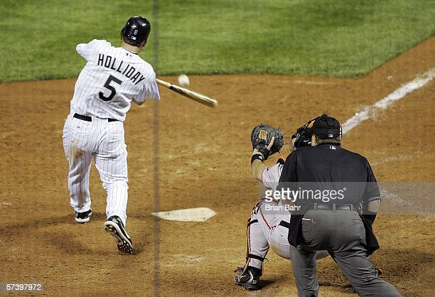 Matt Holliday of the Colorado Rockies hits the gametying RBI single in the bottom of the ninth inning against the San Francisco Giants on April 21...