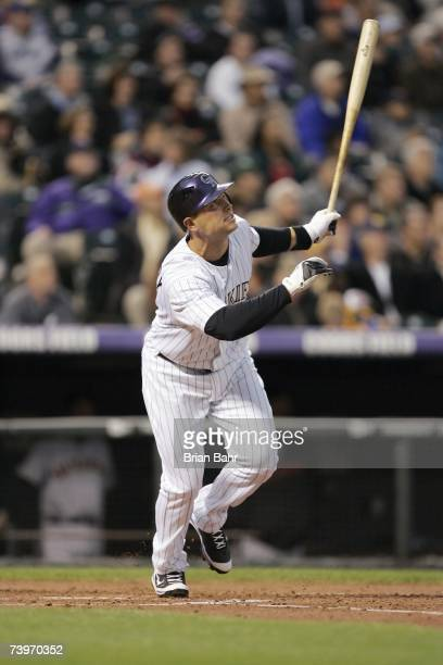 Matt Holliday of the Colorado Rockies makes a hit during the game against the San Francisco Giants on April 16 2007 at Coors Field in Denver Colorado...