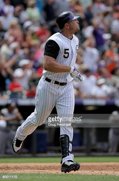 Matt Holliday of the Colorado Rockies watches his solo homerun off of starting pitcher Zach Duke of the Pittsburgh Pirates to give the Rockies 63...