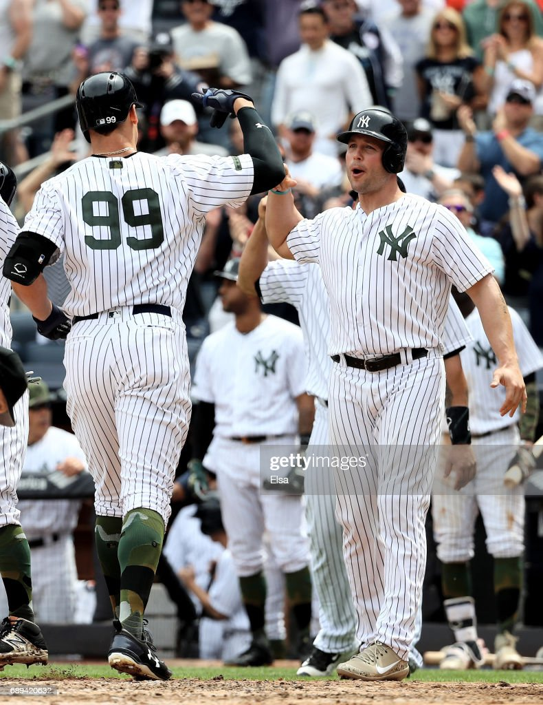 Matt Holliday #17 of the New York Yankees celebrates with teammate Aaron Judge #99 after Judge drove them all home with a grand slam in the third inning against the Oakland Athletics on May 28, 2017 at Yankee Stadium in the Bronx borough of New York City.