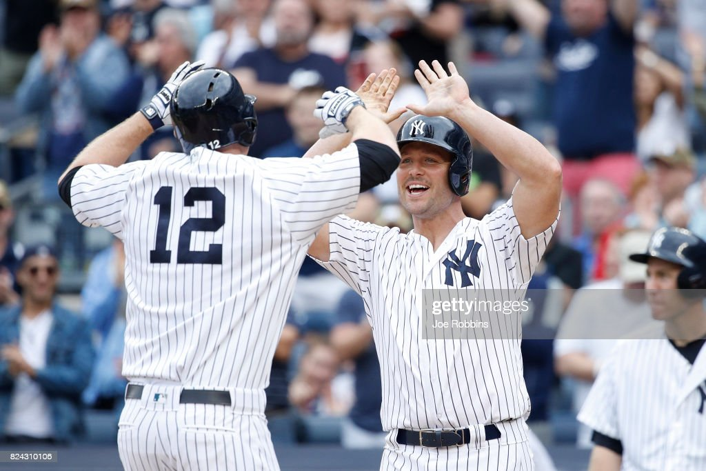 Matt Holliday #17 of the New York Yankees congratulates Chase Headley #12 after he hit a two-run home run in the sixth inning of a game against the Tampa Bay Rays at Yankee Stadium on July 29, 2017 in the Bronx borough of New York City. The Yankees defeated the Rays 5-4.