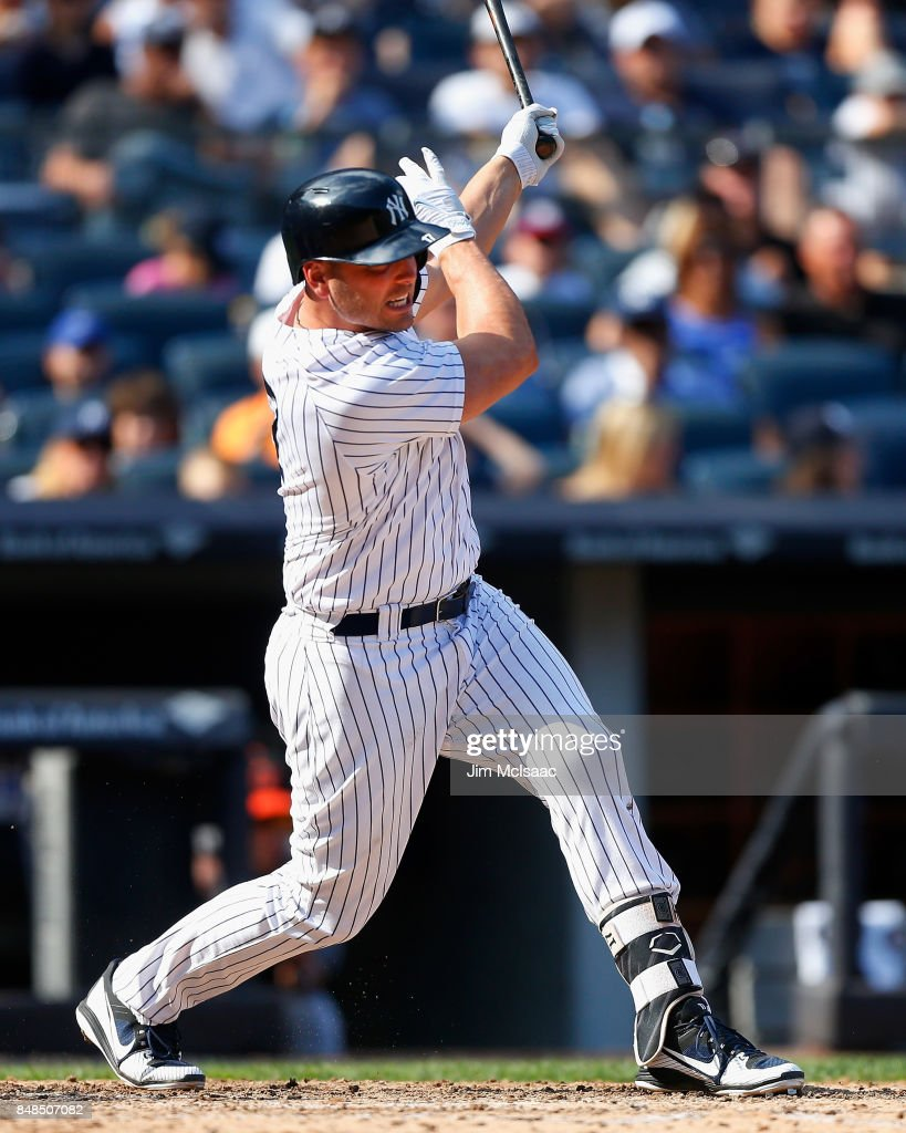 Matt Holliday #17 of the New York Yankees follows through on a sixth inning two run double against the Baltimore Orioles at Yankee Stadium on September 17, 2017 in the Bronx borough of New York City.