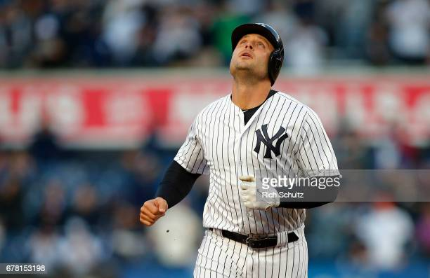 Matt Holliday of the New York Yankees looks to the sky as he rounds the bases after hitting a threerun home run in the first inning against the...
