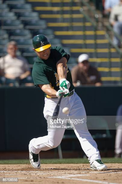 Matt Holliday of the Oakland Athletics at bat during the game against the Milwaukee Brewers at the Phoenix Municpal Stadium in Phoenix Arizona on...