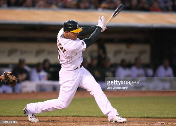 Matt Holliday of the Oakland Athletics hits an RBI single in the second inning against the Boston Red Sox at a Major League Baseball game on April...