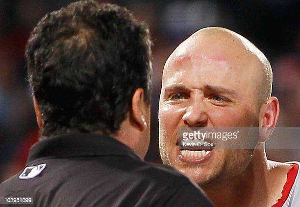 Matt Holliday of the St Louis Cardinals argues with homeplate umpire Mike DiMuro after getting ejected in the fourth inning against the Atlanta...