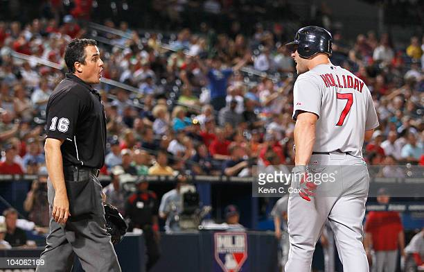 Matt Holliday of the St Louis Cardinals argues with homeplate umpire Mike DiMuro before getting ejected in the fourth inning against the Atlanta...