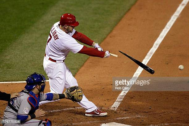 Matt Holliday of the St Louis Cardinals breaks his bat in the fourth inning during Game Two of the MLB World Series against the Texas Rangers at...
