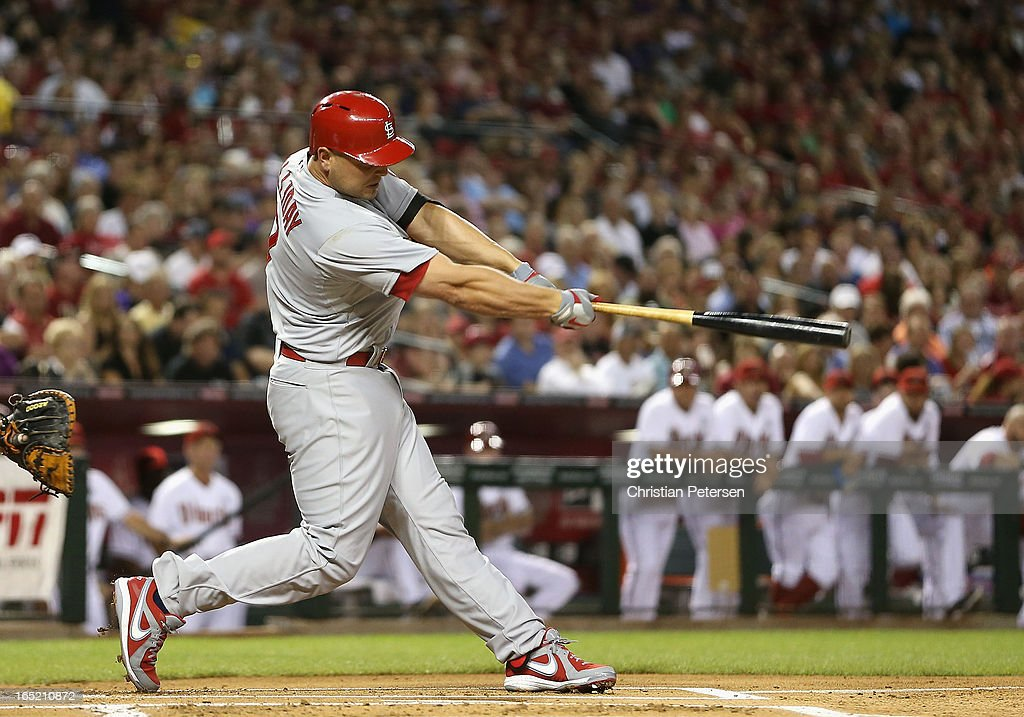 Matt Holliday #7 of the St. Louis Cardinals hits a RBI double against the Arizona Diamondbacks during the first inning of the MLB Opening Day game at Chase Field on April 1, 2013 in Phoenix, Arizona.