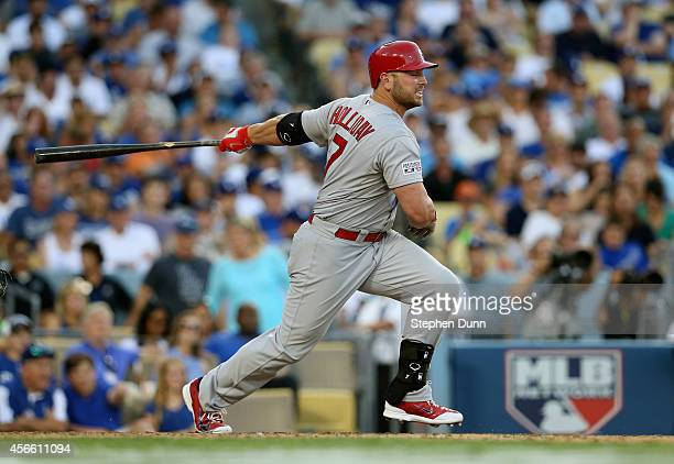 Matt Holliday of the St Louis Cardinals hits a single in the seventh inning against the Los Angeles Dodgers during Game One of the National League...