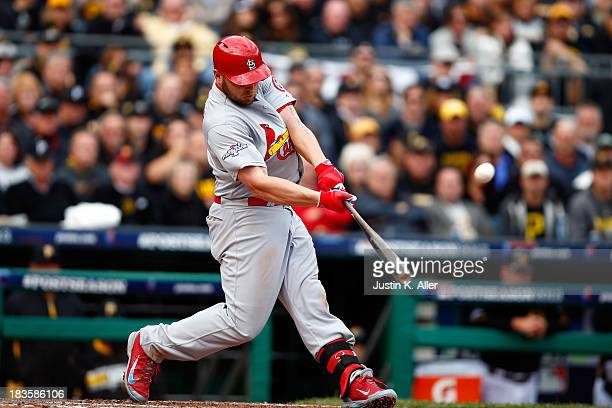 Matt Holliday of the St Louis Cardinals hits a two run home run against Charlie Morton of the Pittsburgh Pirates in the sixth inning during Game Four...