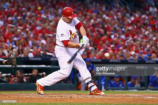 Matt Holliday of the St Louis Cardinals hits an RBI single in the first inning against the Chicago Cubs during game one of the National League...