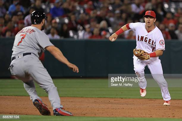 Matt Holliday of the St Louis Cardinals is called out for leaving the baseline trying to elude Cliff Pennington of the Los Angeles Angels of Anaheim...