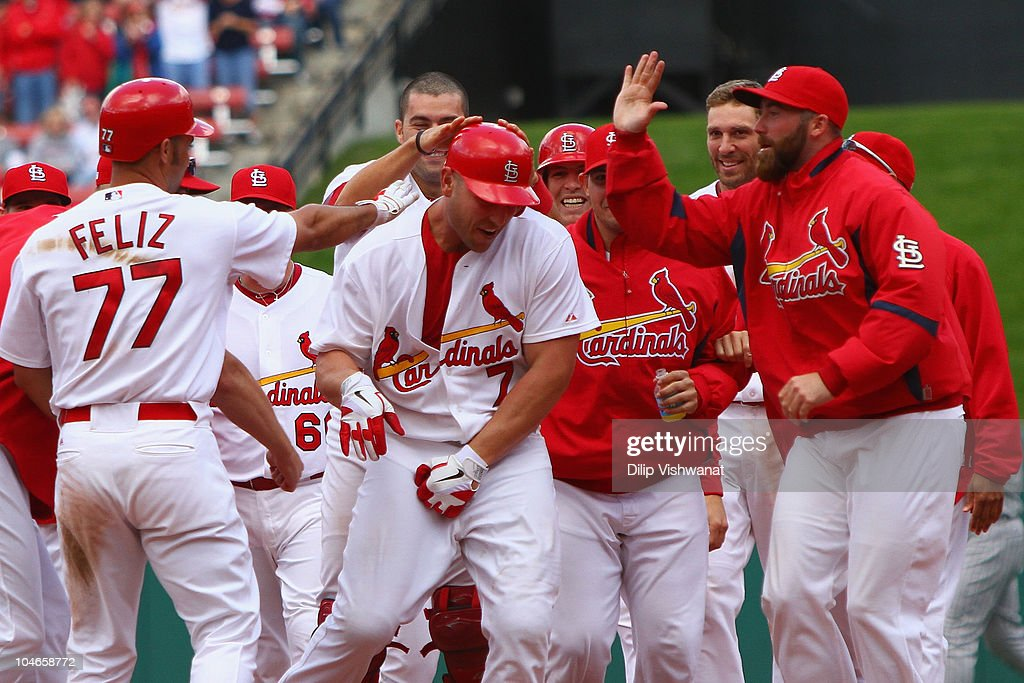 Matt Holliday #7 of the St. Louis Cardinals is congratulated by teammates after hitting a walk-off single against the Colorado RockiesI at Busch Stadium on October 2, 2010 in St. Louis, Missouri. The Cardinals beat the Rockies 1-0 in 11 innings.