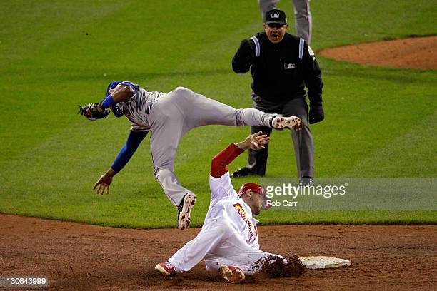 Matt Holliday of the St Louis Cardinals is out at second base by Elvis Andrus of the Texas Rangers on a fielders choice in the fourth inning during...