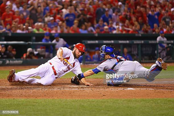 Matt Holliday of the St Louis Cardinals is tagged out at home by Miguel Montero of the Chicago Cubs in the fourth inning at Busch Stadium on April 19...