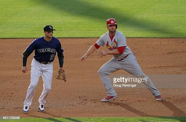 Matt Holliday of the St. Louis Cardinals leaves second base and heads home to score on a single by Matt Adams of the St. Louis Cardinals as shortstop...