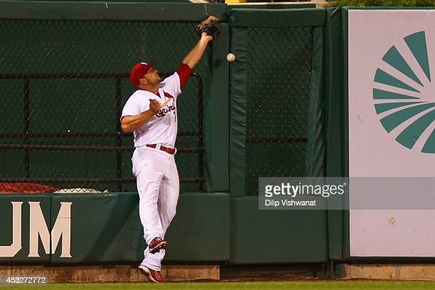 Matt Holliday of the St Louis Cardinals misplays a deep fly ball allowing the Boston Red Sox to score a run in the fourth inning at Busch Stadium on...