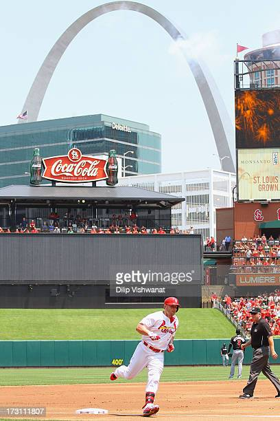 Matt Holliday of the St Louis Cardinals rounds third base after hitting a solo home run off of starter Jose Fernandez of the Miami Marlins in the...