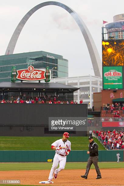 Matt Holliday of the St Louis Cardinals rounds third base against the San Diego Padres on opening day at Busch Stadium on March 31 2011 in St Louis...