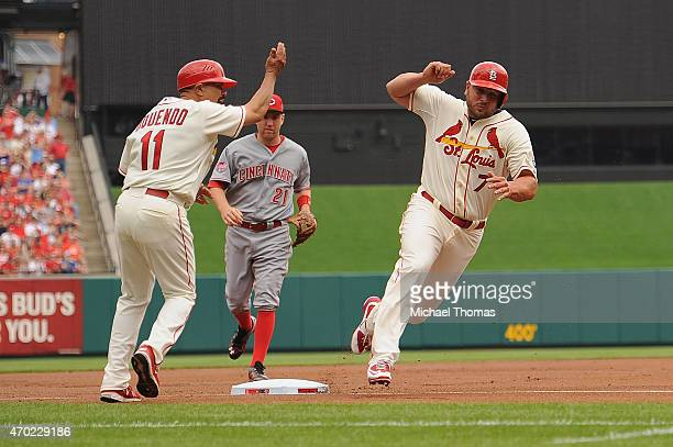 Matt Holliday of the St Louis Cardinals rounds third base to score in the first inning against the Cincinnati Reds at Busch Stadium on April 18 2015...