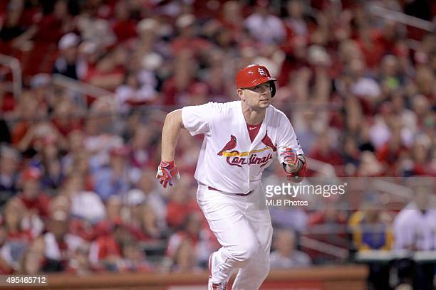 Matt Holliday of the St Louis Cardinals runs to first base for his 45th consecutive game onbase streak during an MLB game against the Milwaukee...