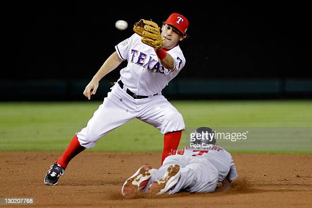 Matt Holliday of the St Louis Cardinals slides into second base safely ahead of the tag by Ian Kinsler of the Texas Rangers after a wild pitch in the...