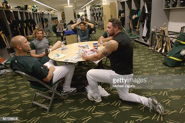 Matt Holliday Travis Buck Kurt Suzuki and Jason Giambi of the Oakland Athletics in the clubhouse prior to the game against the Milwaukee Brewers at...