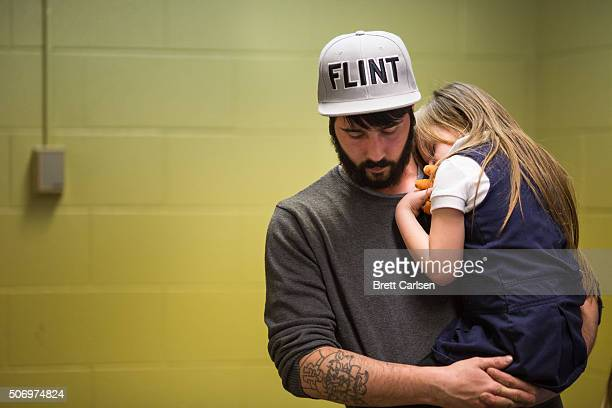 Matt Hopper holds and comforts Nyla Hopper age 5 of Flint after she has her blood drawn to be tested for lead on January 26 2016 at Eisenhower...