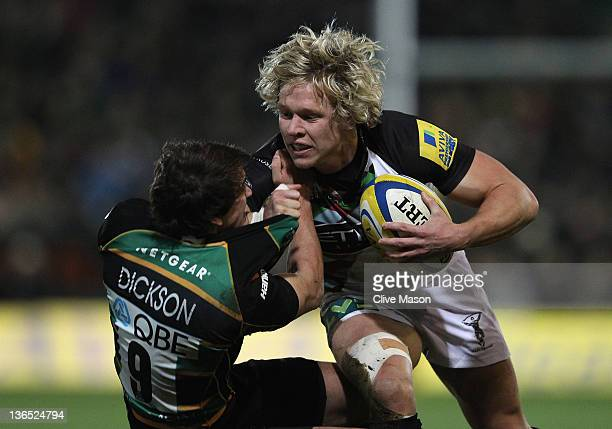 Matt Hopper of Harlequins is tackled by Lee Dickson of Northampton Saints during the Aviva Premiership match between Northampton Saints and...
