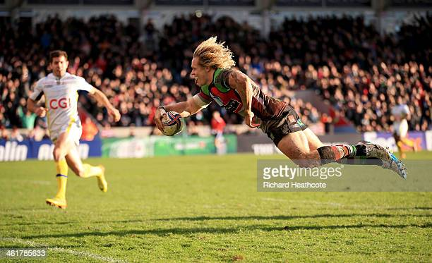 Matt Hopper of Quins dives over to score a try during the Heineken Cup match between Harlequins and Clermont Auvergne at the Twickenham Stoop on...