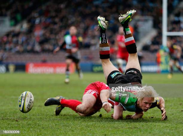 Matt Hopper of Quins is upended during the LV= Cup match between Harlequins and London Welsh at Twickenham Stoop on January 26 2013 in London England