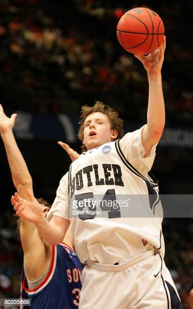 Matt Howard of the Butler Bulldogs shoots over the defense of Philip Tabet of the South Alabama Jaguars during the first round of the South Regional...