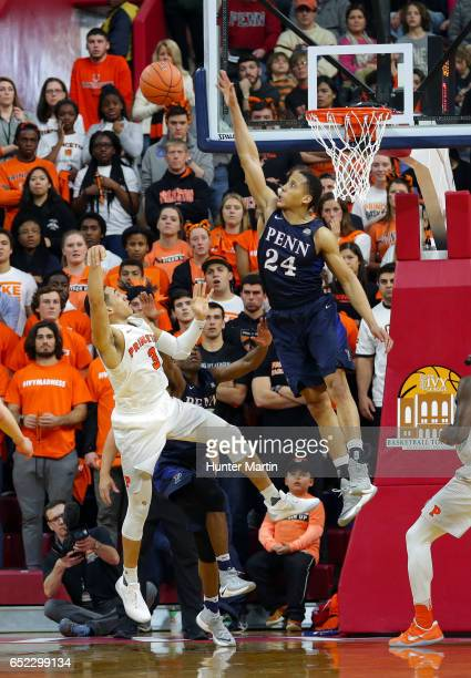 Matt Howard of the Pennsylvania Quakers blocks a shot during a game against the Princeton Tigers at The Palestra during the semifinals of the Ivy...