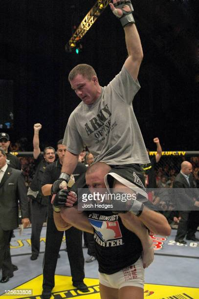 Matt Hughes is hoisted up on Georges StPierre's shoulders after Hughes defeated StPierre in their welterweight championship bout at UFC 50 at the...