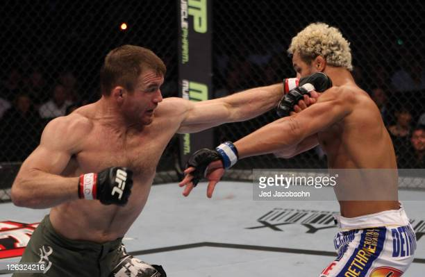 Matt Hughes punches Josh Koscheck during the UFC 135 event at the Pepsi Center on September 24 2011 in Denver Colorado