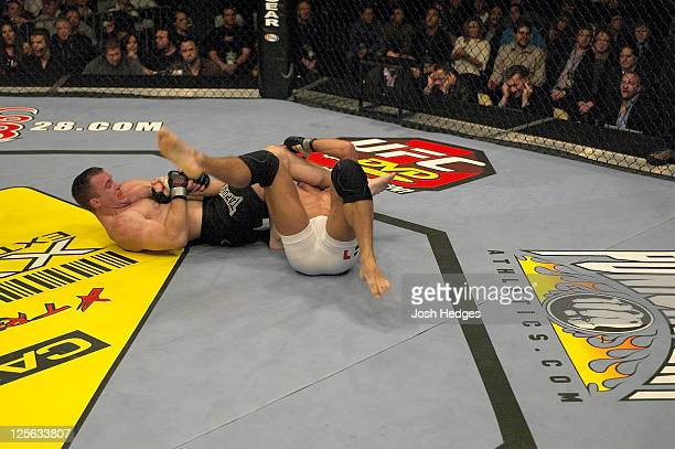 Matt Hughes secures an arm bar submission against Georges StPierre during their welterweight championship bout at UFC 50 at the Boardwalk Hall on...