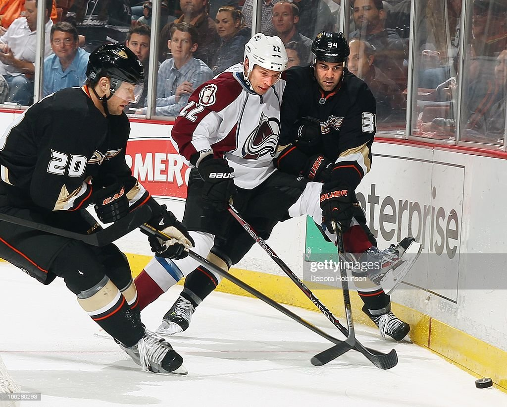 Matt Hunwick #22 of the Colorado Avalanche works to get the puck past David Steckel #20 and Daniel Winnik #34 of the Anaheim Ducks April 10, 2013 at Honda Center in Anaheim, California.