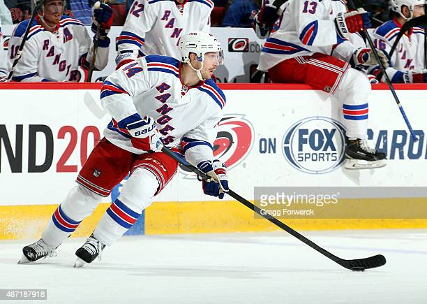 Matt Hunwick of the New York Rangers collects the puck at the blue line during an NHL game against the Carolina Hurricanes at PNC Arena on March 21...