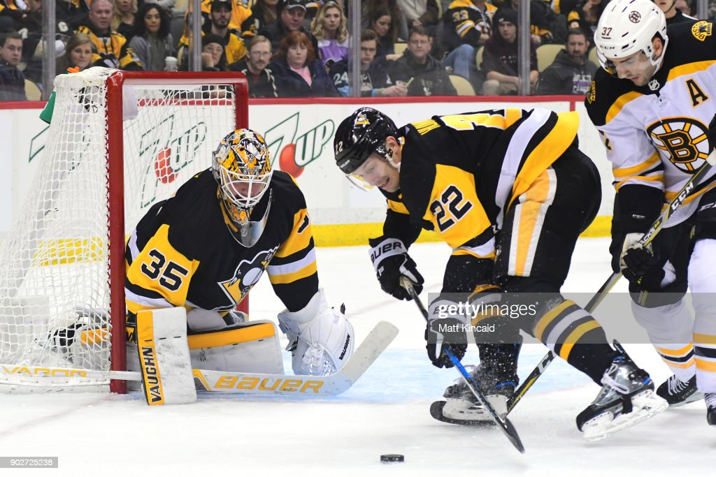 Matt Hunwick #22 of the Pittsburgh Penguins reaches for the puck against the Boston Bruins at PPG PAINTS Arena on January 7, 2018 in Pittsburgh, Pennsylvania.