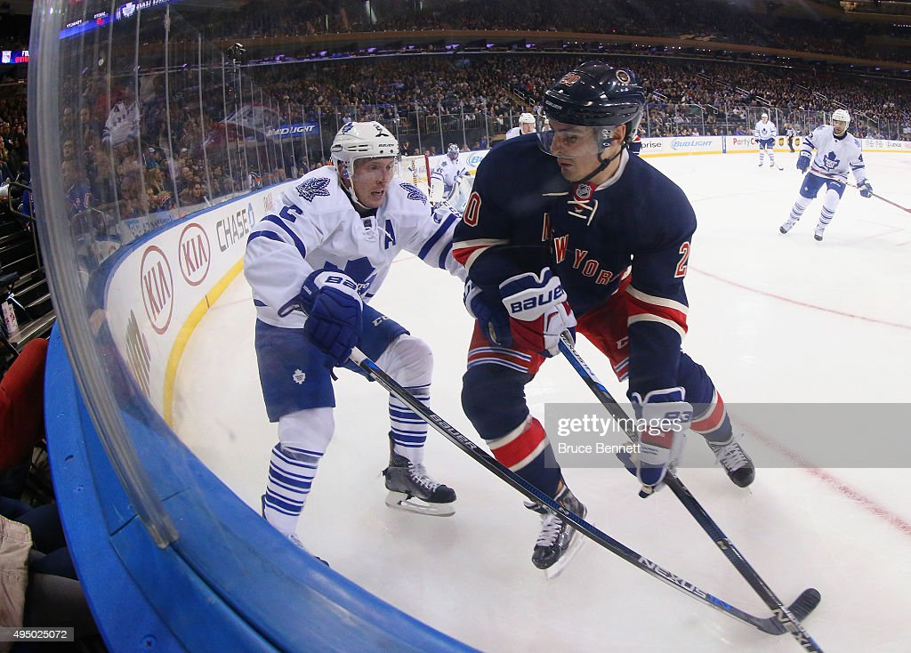 Matt Hunwick #2 of the Toronto Maple Leafs battles with Chris Kreider #20 of the New York Rangers during the second period at Madison Square Garden on October 30, 2015 in New York City.