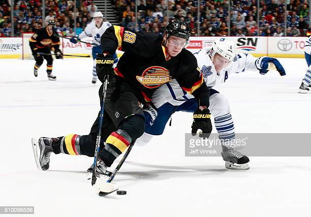 Matt Hunwick of the Toronto Maple Leafs checks Jake Virtanen of the Vancouver Canucks during their NHL game at Rogers Arena February 13 2016 in...