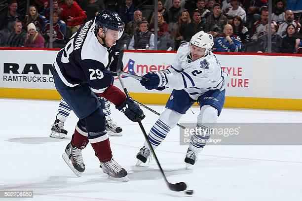 Matt Hunwick of the Toronto Maple Leafs draws a penalty for slashing against Nathan MacKinnon of the Colorado Avalanche at Pepsi Center on December...
