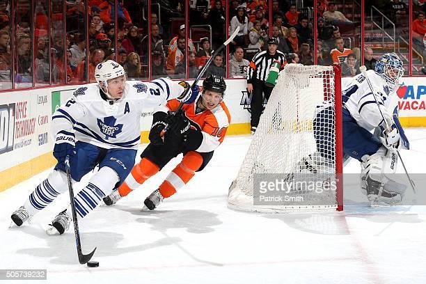 Matt Hunwick of the Toronto Maple Leafs skates past Brayden Schenn of the Philadelphia Flyers during the second period at Wells Fargo Center on...