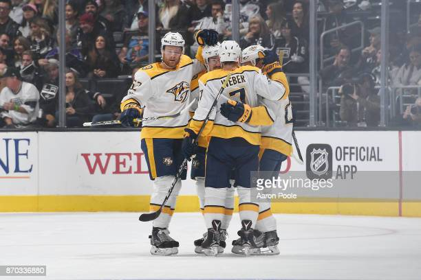 Matt Irwin and Yannick Weber of the Nashville Predators celebrate with teammates after scoring a goal against the Los Angeles Kings at STAPLES Center...